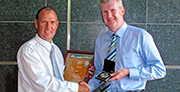 Tony Burke MP, Minister for Agriculture, Fisheries and Forestry presents Bill Crabtree with the 24th McKell Medal